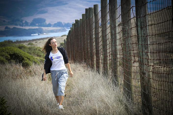 Fleur Dawes walks along a fence in the Point Reyes National Seashore.