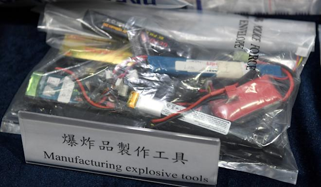 Tung Sheung and Ting Chin were initially accused of possessing explosive powders and two modified phone devices attached with a circuit board – as part of an improvised explosive device. Photo: Xinhua