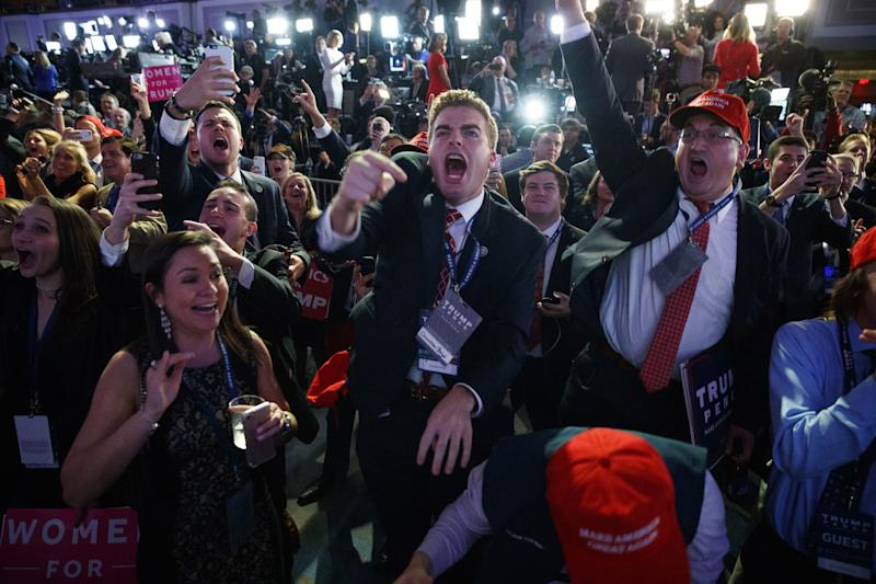 Supporters of Republican presidential candidate Donald Trump cheer as they watch election returns during an election night rally, Tuesday, Nov. 8, 2016, in New York. (Photo: Evan Vucci/AP)