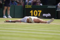 Tunisia's Ons Jabeur celebrates winning the women's singles third round match against Spain's Garbine Muguruza on day five of the Wimbledon Tennis Championships in London, Friday July 2, 2021. (AP Photo/Kirsty Wigglesworth)
