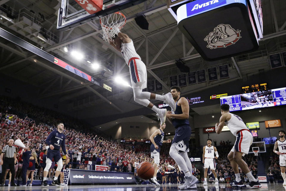 Gonzaga guard Geno Crandall dunks during the first half of the team's NCAA college basketball game against BYU in Spokane, Wash., Saturday, Feb. 23, 2019. (AP Photo/Young Kwak)