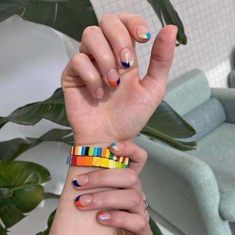"""<p>Pick two different colors for each nail, and paint half of the tip with one and the other half with the other. To be as precise as possible, you can use guide strips to make the lines clean.</p><p><a class=""""link rapid-noclick-resp"""" href=""""https://www.amazon.com/dp/B07V82JFVN/?tag=syn-yahoo-20&ascsubtag=%5Bartid%7C10055.g.1267%5Bsrc%7Cyahoo-us"""" rel=""""nofollow noopener"""" target=""""_blank"""" data-ylk=""""slk:SHOP STRIPING TAPE"""">SHOP STRIPING TAPE</a></p><p><a href=""""https://www.instagram.com/p/CBjAn4cJWp0/&hidecaption=true"""" rel=""""nofollow noopener"""" target=""""_blank"""" data-ylk=""""slk:See the original post on Instagram"""" class=""""link rapid-noclick-resp"""">See the original post on Instagram</a></p>"""