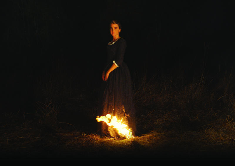"""This image released by Neon shows Adèle Haenel in a scene from the film, """"Portrait of a Lady on Fire."""" (Neon via AP)"""
