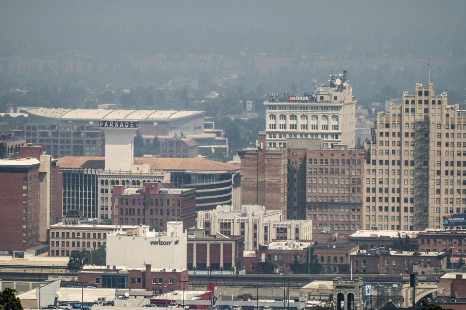 Smoke from area wildfires blankets downtown Spokane, Wash, Saturday, July 10, 2021. (Colin Mulvany/The Spokesman-Review via AP)