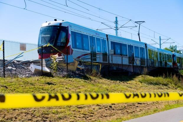 Caution tape is strung up next to the site of an LRT train derailment on Ottawa's Confederation Line on Sept. 19, 2021. No one was injured when the train left the tracks. (Nicholas Cleroux/Radio-Canada - image credit)
