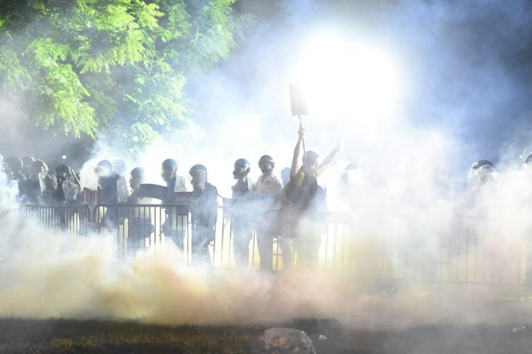 Protests near to the White House have been dispersed by tear gas (AFP Photo/ROBERTO SCHMIDT)
