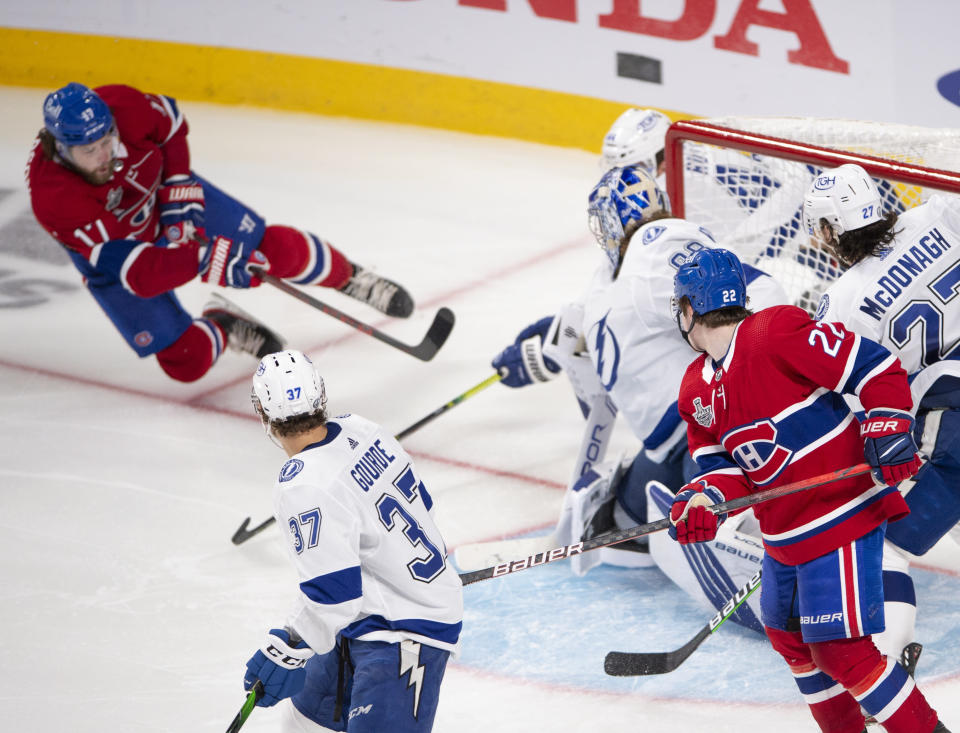 Montreal Canadiens' Josh Anderson (17) scores the winning goal against Tampa Bay Lightning's goaltender Andrei Vasilevskiy (88) during overtime of Game 4 of the NHL hockey Stanley Cup final in Montreal, Monday, July 5, 2021. (Ryan Remiorz/The Canadian Press via AP)