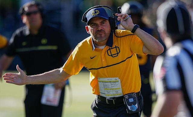 Oregon coach Mark Helfrich is on the hot seat after another blowout loss. (Getty Images)