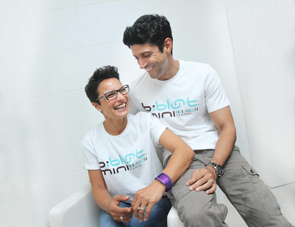 NEW DELHI, INDIA - JULY 20: Indian Bollywood director, producer and actor Farhan Akhtar and his wife Adhuna Akhtar pose for the camera during an exclusive profile shoot on July 20, 2013 in New Delhi, India. Farhan Akhtar was in town to launch his celebrity hairstylist wife Adhuna Akhtars salon. The couple has been married for 13 years, and has two daughters. Adhuna, 46, is six years older than Farhan, 39. (Photo by Raajessh Kashyap/Hindustan Times via Getty Images)