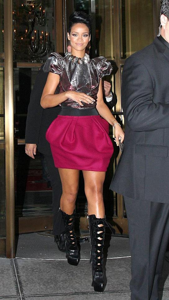 "Rihanna strikes again in a futuristic Louis Vuitton getup. I'm on the fence. I think I might like the skirt, love the top, and hate the boots. What about you? Discuss. <a href=""http://www.infdaily.com"" target=""new"">INFDaily.com</a> - May 7, 2009"