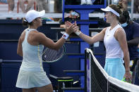 Ashleigh Barty, left, of Australia, and Elina Svitolina, of Ukraine, meet at the net after their semifinal at the Miami Open tennis tournament Thursday, April 1, 2021, in Miami Gardens, Fla. Barty won 6-3, 6-3. (AP Photo/Lynne Sladky)