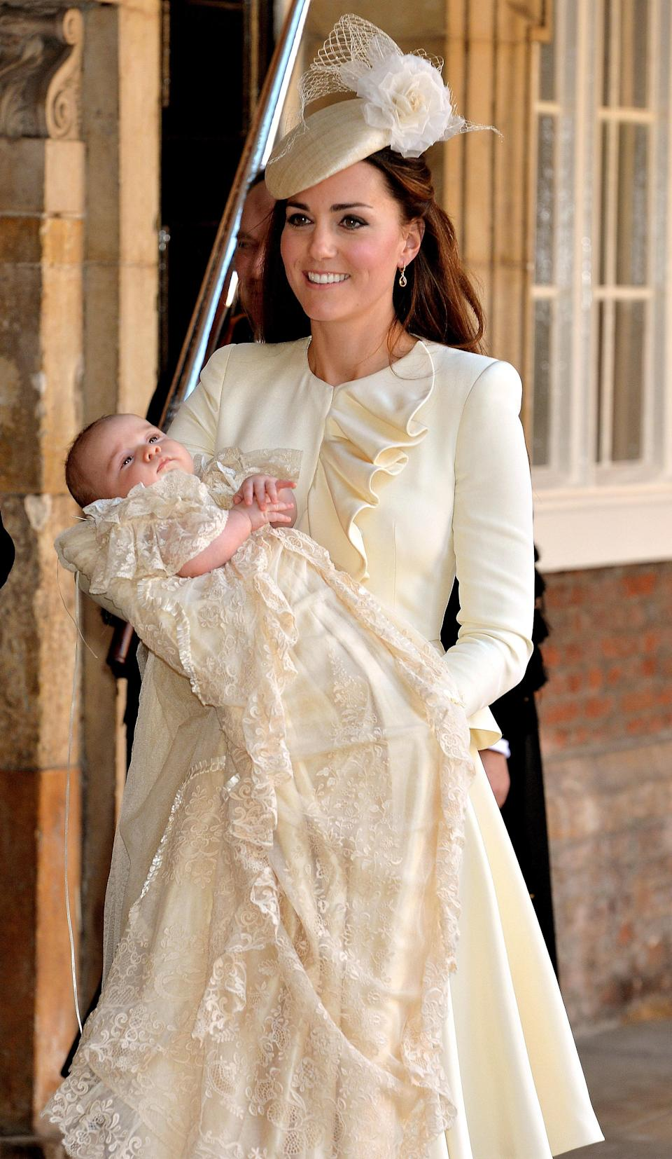 Catherine, Duchess of Cambridge, holding her son, Prince George at his christening.
