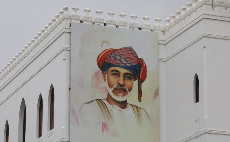 A painting of Oman's Sultan Qaboos bin Said is seen on a building in Muscat