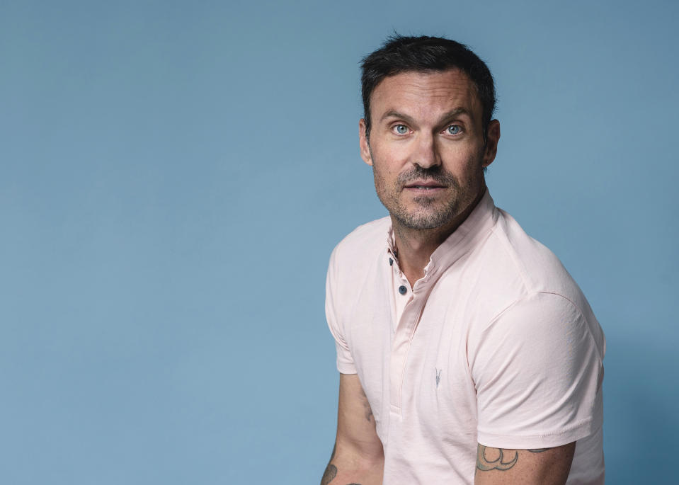 """Brian Austin Green poses for a portrait at The Associated Press on Tuesday, Aug. 13, 2019, in New York City. Green says if Tori Spelling and Jennie Garth, along with the other creators of """"BH90210,"""" had approached him with a standard reboot of the 90s drama, he would've said no. (Photo by Christopher Smith/Invision/AP)"""