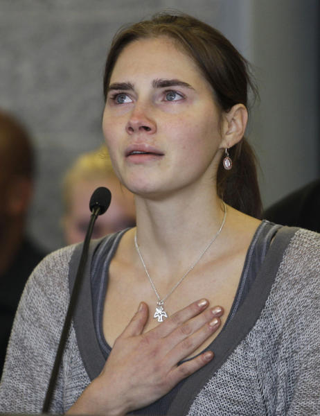 FILE - In this Tuesday, Oct. 4, 2011 file photo, Amanda Knox talks to reporters, in Seattle. A court in Florence that convicted Amanda Knox in her British roommate's 2007 murder says the wounds indicate multiple aggressors, and that the two exchange students fought over money the night of the murder. The appellate court on Tuesday, April 29, 2014, issued a 337-page explanation for its January guilty verdicts against Knox and her former boyfriend Raffaele Sollecito. Knox, 26, was sentenced to 28 ½ years while Sollecito, 30, received 25 years. Knox has been in the United States since 2011, when an earlier appellate trial that overturned her lower court conviction. Sollecito remains in Italy. The release of the court's reasoning opens the verdict to an appeal back to the supreme Court of Cassation. If the high court confirms the convictions, a long extradition fight for Knox is expected. Kercher, 21, was found dead in a pool of blood in the apartment she and Knox shared in the town of Perugia. (AP Photo/Ted S. Warren, File)
