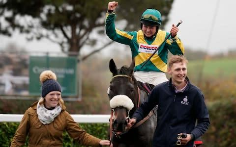 <span>Bryony Frost celebrates after riding Present Man to win The Badger Ales Trophy Handicap Chase last year</span> <span>Credit: Getty Images </span>
