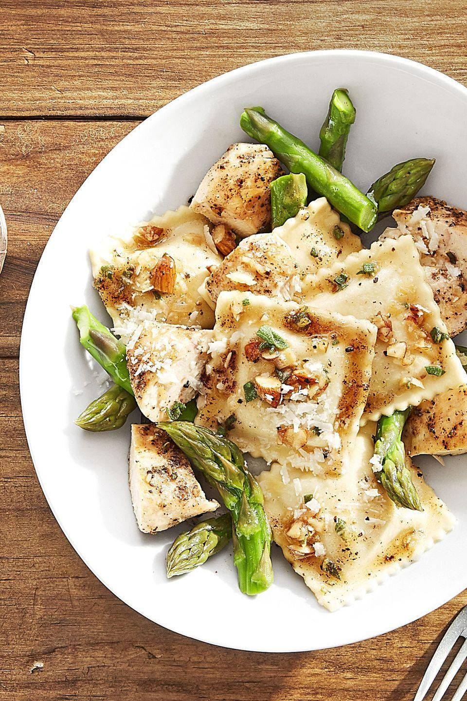 """<p>Make store-bought butternut squash ravioli your own by adding asparagus and seared chicken.</p><p><strong><a href=""""https://www.countryliving.com/food-drinks/recipes/a44277/butternut-squash-ravioli-seared-chicken-recipe/"""" rel=""""nofollow noopener"""" target=""""_blank"""" data-ylk=""""slk:Get the recipe"""" class=""""link rapid-noclick-resp"""">Get the recipe</a>.</strong><br></p><p><a class=""""link rapid-noclick-resp"""" href=""""https://www.amazon.com/HYTX-Stainless-2-Piece-5-Quart-Tempered/dp/B07ZHLSYXV/?tag=syn-yahoo-20&ascsubtag=%5Bartid%7C10050.g.680%5Bsrc%7Cyahoo-us"""" rel=""""nofollow noopener"""" target=""""_blank"""" data-ylk=""""slk:SHOP STOCKPOTS"""">SHOP STOCKPOTS</a> </p>"""