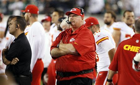 Kansas City Chiefs head coach Andy Reid stands on the sidelines at the start of their NFL football game against the Philadelphia Eagles in Philadelphia, Pennsylvania, September 19, 2013. REUTERS/Tom Mihalek
