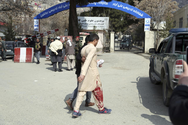 An injured man is taken to a hospital in Kabul, Afghanistan, Thursday, March 21, 2019. An Afghan official says three explosions have struck near a Shiite shrine and cemetery in western Kabul as people gathered there to mark the holiday of Nowruz, the Persian New Year.(AP Photo/Rahmat Gul)