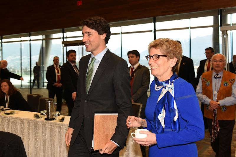 "Ontario Premier Kathleen Wynne (L), pictured in March 2016, says the province wants to ""find out whether a basic income makes a positive impact in people's lives"""