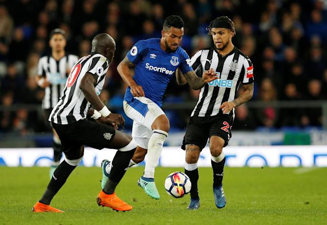"Soccer Football - Premier League - Everton v Newcastle United - Goodison Park, Liverpool, Britain - April 23, 2018 Everton's Theo Walcott in action with Newcastle United's DeAndre Yedlin and Mohamed Diame REUTERS/Andrew Yates EDITORIAL USE ONLY. No use with unauthorized audio, video, data, fixture lists, club/league logos or ""live"" services. Online in-match use limited to 75 images, no video emulation. No use in betting, games or single club/league/player publications. Please contact your account representative for further details."