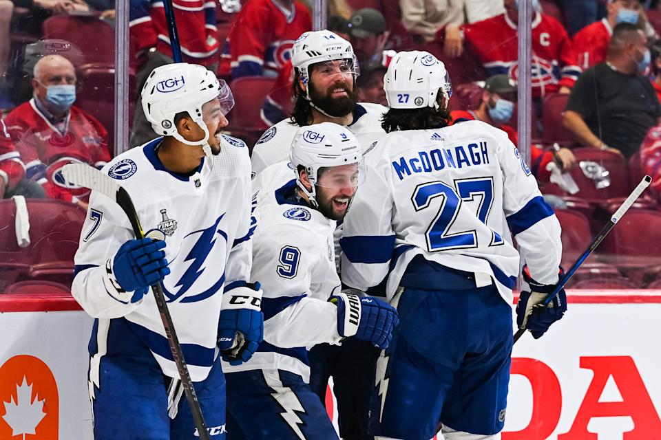 MONTREAL, QC - JULY 02: Tampa Bay Lightning center Tyler Johnson (9) shows pride after scoring and celebrating his goal with his teammates during the NHL Stanley Cup Playoffs Final game 3 between the Tampa Bay Lightning versus the Montreal Canadiens on July 02, 2021, at Bell Centre in Montreal, QC (Photo by David Kirouac/Icon Sportswire via Getty Images)