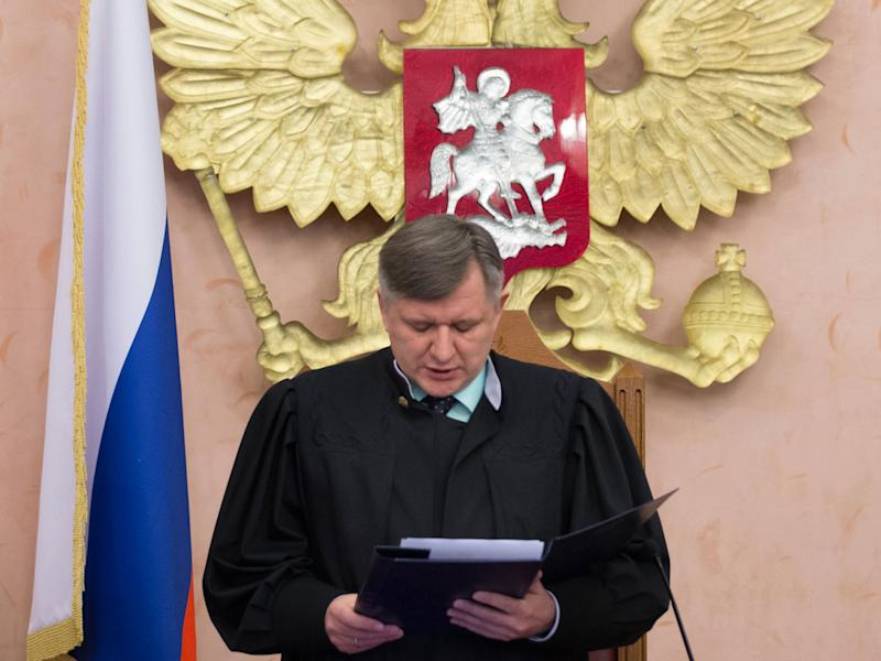 Supreme Court judge Yuri Ivanenko reads the decision in a courtroom in Moscow Thursday: AP