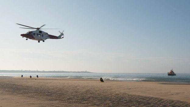 A helicopter hovering over the Aberdeenshire beach where the incident unfolded on Monday. (RNLI Fraserburgh)