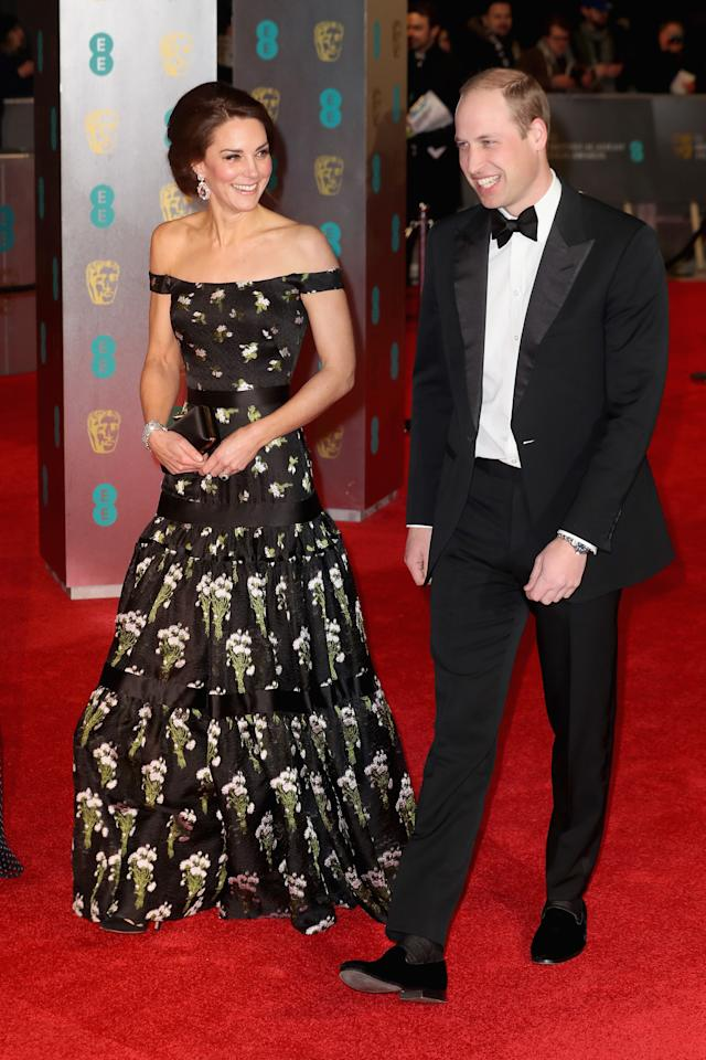 <p>For her debut BAFTA appearance alongside Prince William, the Duchess of Cambridge opted for a cold-shoulder dress by Alexander McQueen. <em>[Photo: Getty] </em> </p>