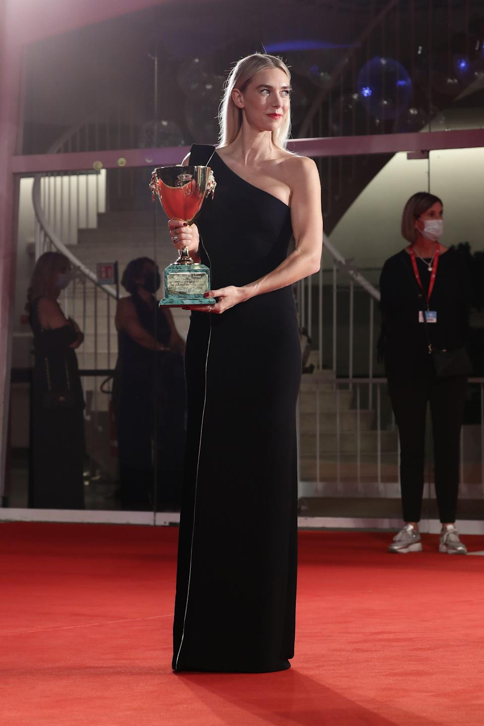 "Vanessa Kirby poses with the Coppa Volpi prize for best actress in ""Pieces of a Woman"" at the Venice Film Festival."