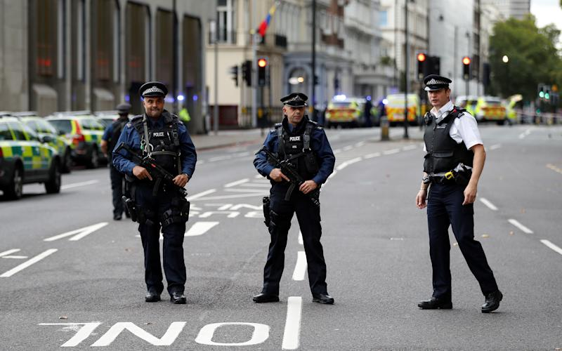 <strong>Police officers stand in the road outside the Natural History Museum</strong> (Peter Nicholls / Reuters)