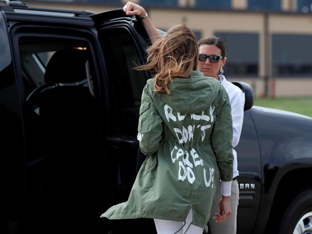 """U.S. first lady Melania Trump walks from her to her motorcade wearing a Zara design jacket with the phrase """"I Really Don't Care. Do U?"""" on the back as she returns to Washington from a visit to the U.S.-Mexico border area in Texas, at Joint Base Andrews, Maryland, U.S., June 21, 2018. REUTERS/Kevin Lamarque? TPX IMAGES OF THE DAY"""