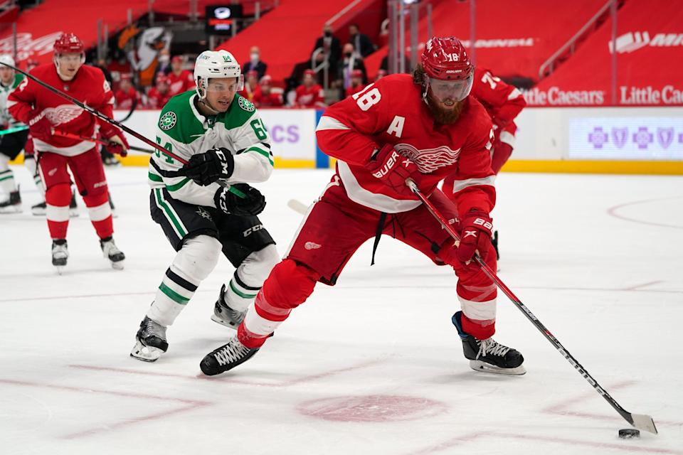 Red Wings defenseman Marc Staal protects the puck from Stars center Tanner Kero in the third period of the Wings' 2-1 overtime loss on Saturday, April 24, 2021, at Little Caesars Arena.