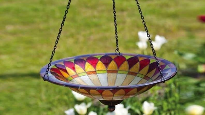 This hanging glass bird bath is a perfect gift for gardeners.