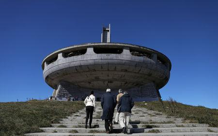 Laurent Levi-Strauss and Graham Bell, experts at heritage organisation Europa Nostra and Mario Aymerich, technical consultant of the European Investment Bank Institute walk in front of Buzludzha Monument, Stara Planina mountain, September 27, 2018. REUTERS/Stoyan Nenov