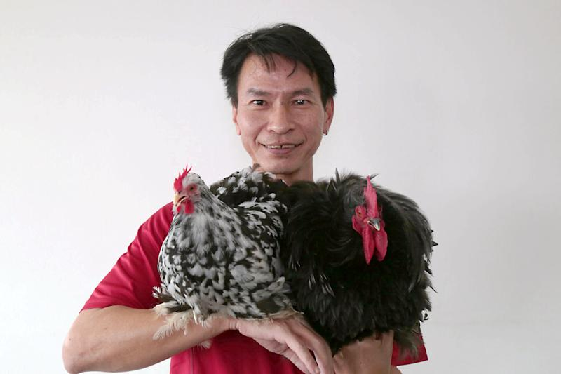 "Woo with his ""mini Cochins"", Coco (left) and Kiki. (PHOTO: Dhany Osman / Yahoo News Singapore)"