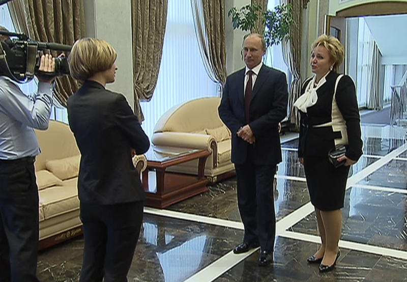 """In this grab made from video provided by the Russia24 TV Channel on Thursday, June 6, 2013, Russian President Vladimir Putin, second right, and his wife Lyudmila, right, speak to journalists after attending the ballet """"La Esmeralda"""" in the Kremlin Palace in Moscow, Russia. Russian President Vladimir Putin and his wife Lyudmila said Thursday they are divorcing after nearly 30 years of marriage, making the announcement on state television after attending a ballet performance at the Kremlin. (AP Photo/Russia24 via The Associated Press Television News) TV OUT"""
