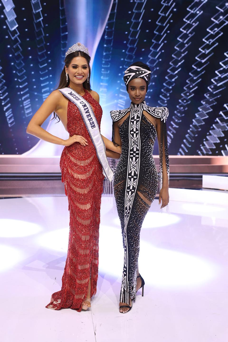 HOLLYWOOD, FLORIDA - MAY 16: Miss Universe 2020 Andrea Meza and Miss Universe 2019 Zozibini Tunzi pose onstage at the 69th Miss Universe competition at Seminole Hard Rock Hotel & Casino on May 16, 2021 in Hollywood, Florida. (Photo by Rodrigo Varela/Getty Images)