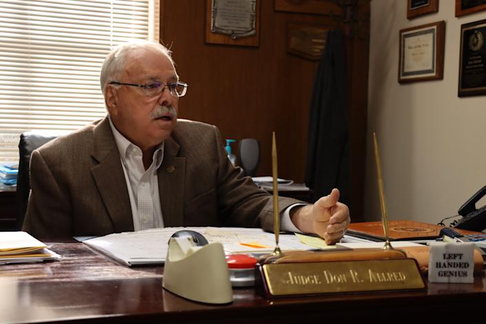 Oldham County Judge Don R. Allred. Allred has been county judge for nearly three decades. When COVID-19 hit his county, Allred tried to keep the town calm by squelching rumors and trying to explain procedures for handling the disease.