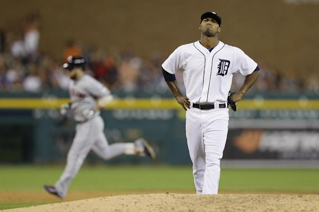 Detroit Tigers relief pitcher Al Alburquerque reacts as Cleveland Indians' Jason Kipnis rounds the bases after his three-run home run in the seventh inning of a baseball game in Detroit, Friday, July 18, 2014. (AP Photo/Carlos Osorio)