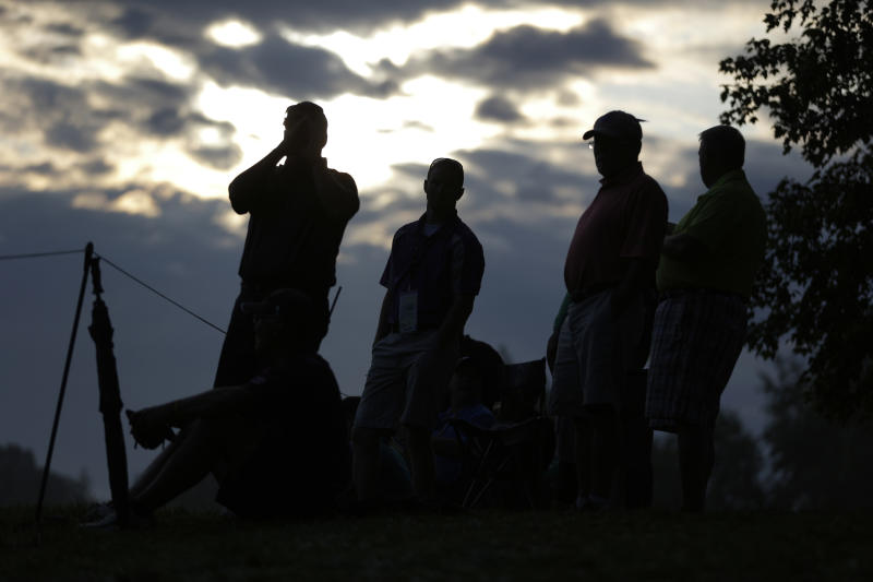 Members of the gallery wait for the start of the first round of the PGA Championship golf tournament at Oak Hill Country Club, Thursday, Aug. 8, 2013, in Pittsford, N.Y. (AP Photo/Julio Cortez)