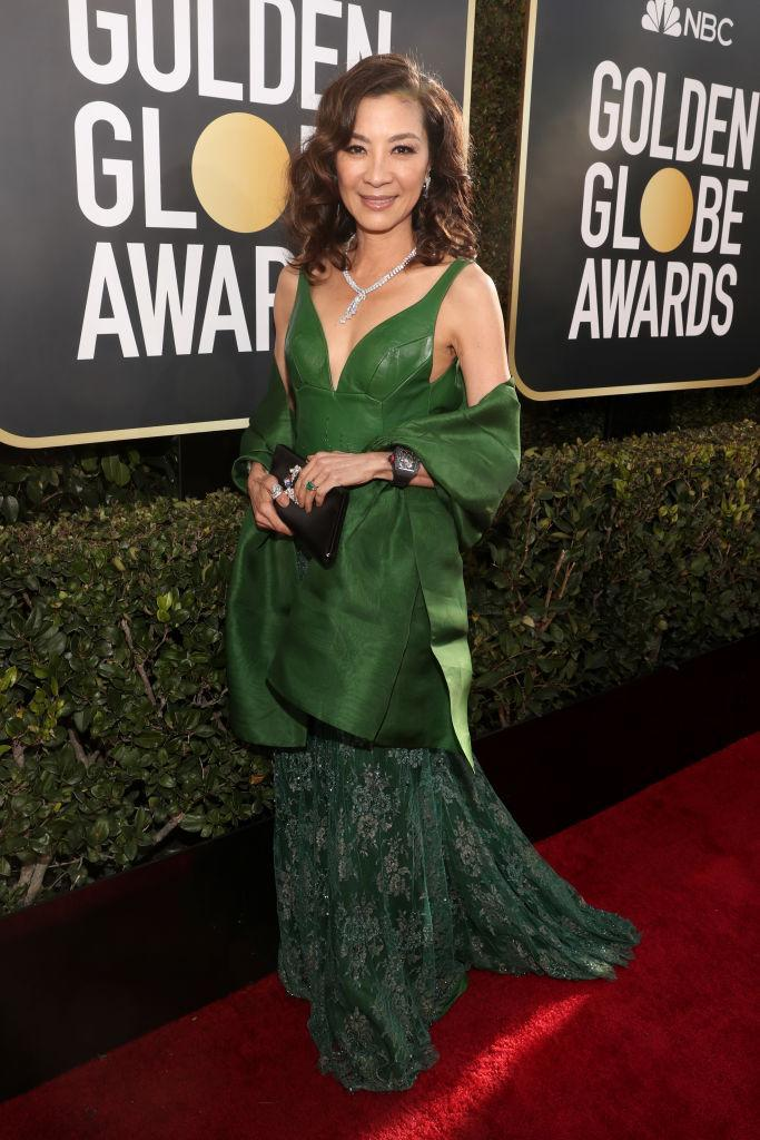 <p><i>Crazy Rich Asians</i> star Michelle Yeoh, 56, was breathtaking in green. She completed her look with the emerald engagement ring that her character, Eleanor Young, wore in the rom-com. (Photo: Getty Images) </p>