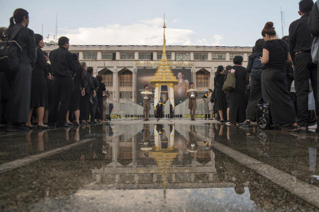 <p>Thai mourners stand in a line before laying down sandalwood flowers in a replica of the royal crematorium in Bangkok, Thailand, Thursday, Oct. 26, 2017. The funeral of King Bhumibol Adulyadej, who reigned for 70 years before his death on Oct. 13, 2016. Bhumibol will be honored in an elaborate royal cremation ceremony from Oct. 25 to 29. (Photo: Kittinun Rodsupan/AP) </p>