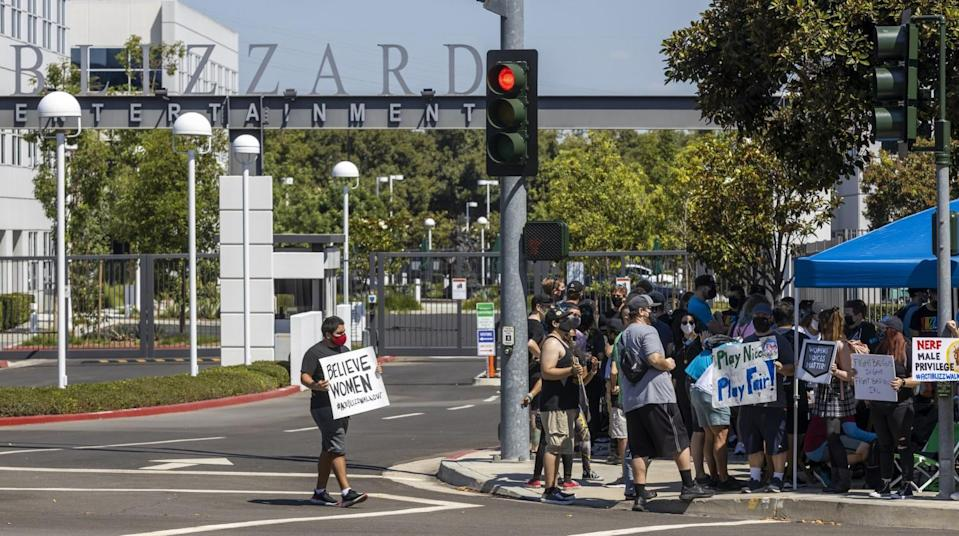 Several hundred Activision Blizzard employees stage a walkout outside the company's Irvine office