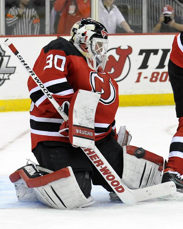 New Jersey Devils goaltender Martin Brodeur makes a save during the first period of an NHL hockey game against the Pittsburgh Penguins, Saturday, Nov. 16, 2013, in Newark, N.J. (AP Photo/Bill Kostroun)