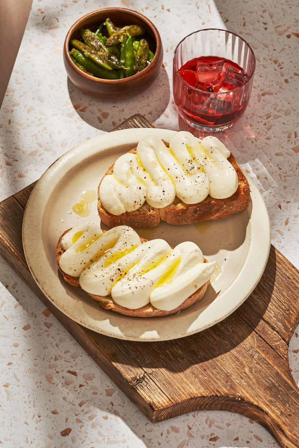 """<p>This light, fluffy whipped ricotta is as close as you can get to eating a cloud.</p><p>Get the recipe from <a href=""""https://www.delish.com/cooking/a36276712/whipped-ricotta-toast-recipe/"""" rel=""""nofollow noopener"""" target=""""_blank"""" data-ylk=""""slk:Delish"""" class=""""link rapid-noclick-resp"""">Delish</a>.</p>"""