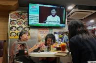 A TV screen shows Hong Kong Chief Executive Carrie Lam talks during a news conference at a restaurant in Hong Kong Wednesday, Oct. 6, 2021. Hong Kong's Chief Executive Carrie Lam announced a major development plan Wednesday, for Hong Kong's border area with mainland China in the last annual policy address of her current term. (AP Photo/Vincent Yu)