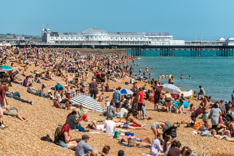 BRIGHTON, ENGLAND - JUNE 22: Crowds enjoy the warm weather on the beach on June 22, 2019 in Brighton, England. Temperatures in south-east England are set to soar with thunderstorm warnings in place for early next week. (Photo by Andrew Hasson/Getty Images)