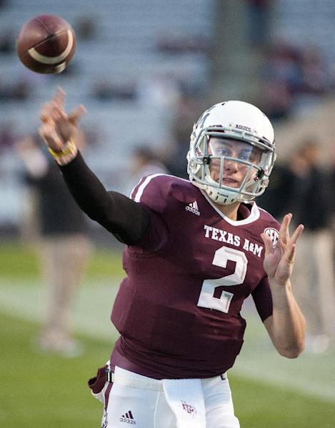 Texas A&M quarterback Johnny Manziel warms up before an NCAA college football game against Missouri, Saturday, Nov. 24, 2012, in College Station, Texas. (AP Photo/Dave Einsel)