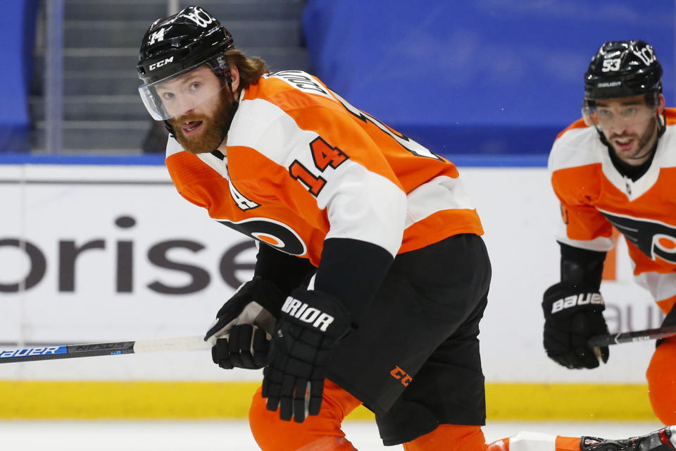 Philadelphia Flyers forward Sean Couturier (14) skates towards the net during the second period of an NHL hockey game against the Buffalo Sabres, Sunday, Feb. 28, 2021, in Buffalo, N.Y. (AP Photo/Jeffrey T. Barnes)